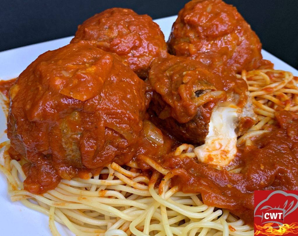 Mozzarella Stuffed Meatballs Recipe delicious tender juicy perfectly seasoned meatballs filled with melted gooey fresh mozzarella cheese. Satisfying cheese pulls with every bite.